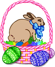 A bunny rabbit sitting on eggs in a basket