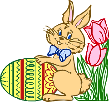 A bunny with a painted Easter egg and some flowers